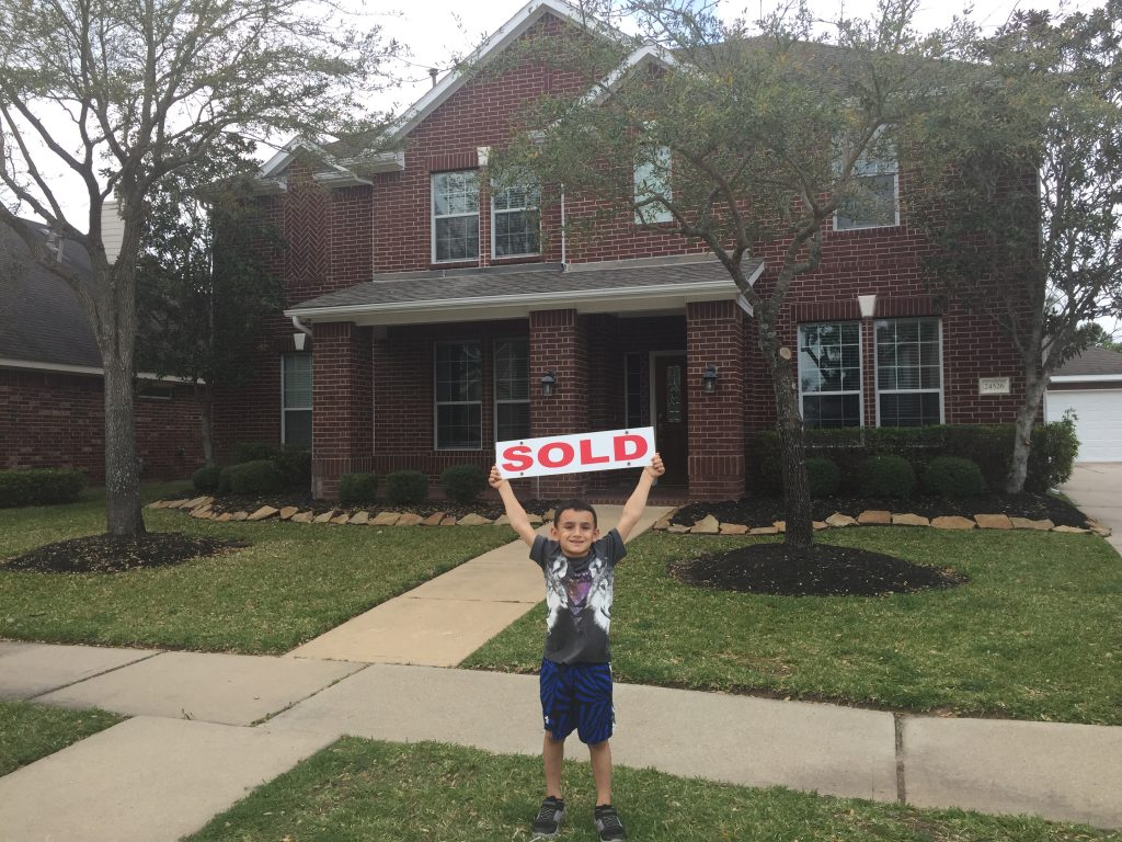 Eli holding sold sign